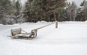 Wooden sledges on poles extending for skiing in a circle. Russian folk fun