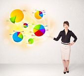 Business woman with colorful graphs and charts concept