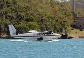 image of float-plane  - Seaplane floating in a bay St Thomas US Virgin Islands - JPG
