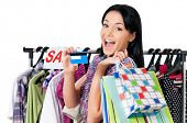 Shopping woman happy smiling holding credit card or gift card, isolated on white background