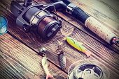 pic of spinner  - fishing tackle on a wooden table - JPG