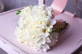 Beautiful wedding bouquet on wooden chair