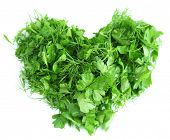Heart shape of chopped herbs, isolated on white