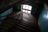 foto of entryway  - Dark abandoned stairway interior in old living house St - JPG
