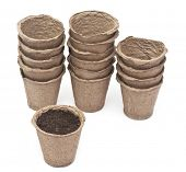 pile peat pots for growing seedlings, isolated on white background