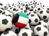 stock photo of kuwait  - Football with flag of kuwait in front of regular balls - JPG