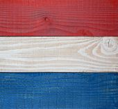 Closeup red, white and blue boards background. Patriotic background for 4th of July or Memorial Day
