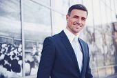 Portrait of a smiling handsome businessman in suit