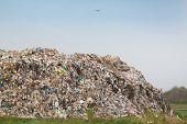stock photo of landfills  - Hill of diverse domestic garbage in landfill - JPG
