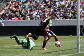 CARSON, CA - APRIL 6: Los Angeles Galaxy F Robbie Keane (7) scores during the MLS game between the L