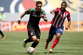 CARSON, CA - APRIL 6: Los Angeles Galaxy M Stefan Ishizaki (24) & Chivas USA F Luke Moore (19) durin