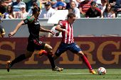 CARSON, CA - APRIL 6: Chivas USA M Leandro Barrera (11) & Los Angeles Galaxy D Omar Gonzalez (4) dur