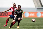 CARSON, CA - APRIL 6: Los Angeles Galaxy F Robbie Keane (7) & Chivas USA D Eriq Zavaleta (22) during