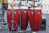 Trio Of Red Conga Drums