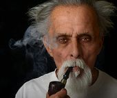 Nice image of a Senior and His Pipe