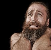foto of beard  - Very Emotional Image of a bearded Homeless man Crying - JPG