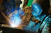stock photo of flames  - welder working with electrode at semi - JPG