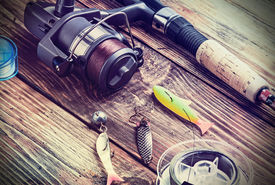 pic of fishing bobber  - fishing tackle on a wooden table - JPG