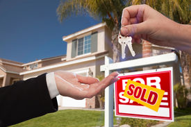 picture of real-estate agent  - Handing Over the House Keys in Front of a Beautiful New Home - JPG