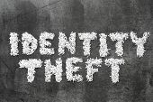 picture of theft  - identity theft phrase made from shredded paper on blackboard surface - JPG