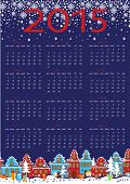 New year calendar.Cute little town in winter night