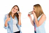 Friends Talking Through A Tin Phone Over White Background