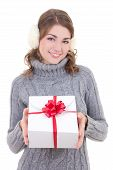 Happy Attractive Woman In Woolen Sweater And Muffs Holding Gift Box Isolated On White