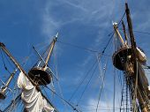 stock photo of tall ship  - Masts of a tall sailing ship reminiscent of a pirate ship - JPG