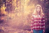 Young Woman walking outdoor wearing hipster plaid shirt Lifestyle