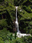 Large Himalayan Waterfall In A Green Mountain Area