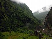 stock photo of landslide  - Ruins of a landslide struck home in the village of Tal during a misty monsoon day in the Annapurna Himalayas Nepal - JPG