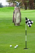 Professional golf equipment on grass in club