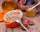 Apple And Figs Crumble On Wooden Background