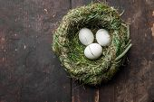 Organic White Eggs In Hay Nest At Wooden Table. Eco Food Composition In Rural Vintage Style