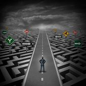 stock photo of riddles  - Crisis solution concept as a businessman standing on a straight road through a maze or labyrinth with confusing direction road signs as a metaphor for finding the answer to a riddle as a clear strategy to overcome difficulties in business and the problems - JPG