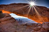 stock photo of arch foot  - Mesa Arch spans 90 feet and stands thousands of feet above the Colorado River gorge - JPG