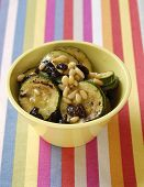 Salad with grilled zucchini, nuts and raisins