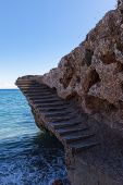 Old Concrete Stairs Eroded By Ocean