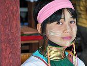 Karen tribe girl poses for the camera in Chiang Mai