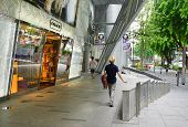 Pedestrians walk along famous Orchard road in Singapore.