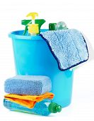foto of bath sponge  - Arrangement of Cleaning Bottles and Sprays into Blue Bucket with Bath Sponge isolated on white background - JPG