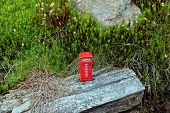 picture of phone-booth  - Red phone booth standing in the forest - JPG