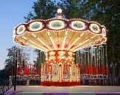 picture of merry-go-round  - Illuminated merry go round carousel in amusement park - JPG