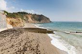 Waves on Charlestown beach near St Austell Cornwall England UK Cornish fishing village and port