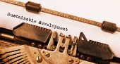stock photo of sustainable development  - Vintage typewriter old rusty warm yellow filter  - JPG