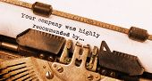 stock photo of recommendation  - Vintage typewriter old rusty warm yellow filter  - JPG