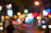 Blur image of street at Kuta, Bali at night with bokeh.