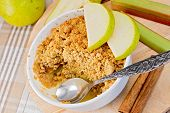 Crumble With Pears And Rhubarb In Bowl On Linen Tablecloth