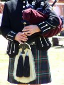 stock photo of bagpiper  - Scottish piper playing bagpipes - JPG