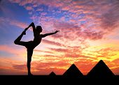 picture of natarajasana  - Man doing yoga at Egyptian Pyramids background in silhouettes - JPG